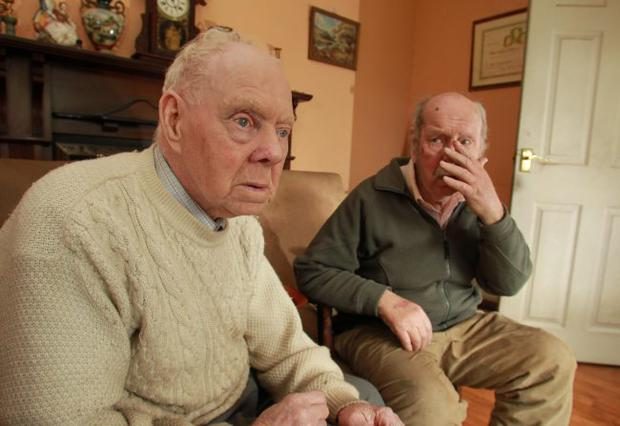 Jimmy (83) (white Jumper) and Paddy (81) Murtagh.the Pensioners where sickly attacked in their own home.