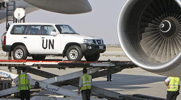 A vehicle for the UN observers is offloaded from a plane at the Damascus airport in Syria (AP)