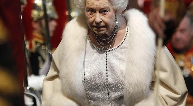Queen Elizabeth arrives at the Palace of Westminster for the State Opening of Parliament