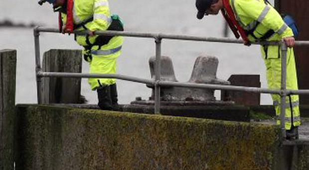 Belfast Lough search resumes after reports of missing baby. A woman, believed to be the baby's mother, was rescued on Wednesday night