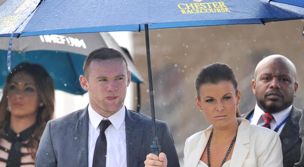 Wayne and Coleen Rooney watch The Manor House Stables Lily Agnes Conditions Stakes at Chester Races during the Stan James Cup Day during the May Festival at Chester Racecourse, Chester