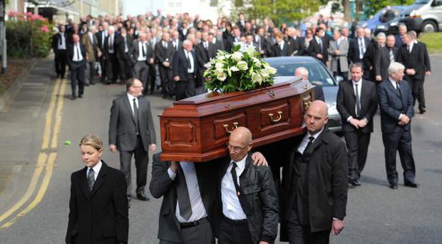 The funeral of Bertie Acheson leaves Wade's funeral home in Coleraine