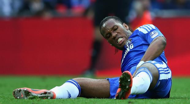There are just too many captions that I can't use for this photograph so we'll just day Didier Drogba hurts himself at Wembley