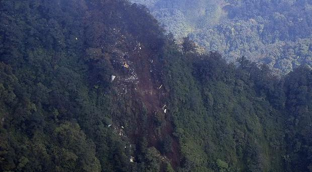 The wreckage of a missing Sukhoi Superjet-100 is scattered on the mountainside in Bogor, West Java, Indonesia (AP)