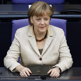 German Chancellor Angela Merkel attends a meeting of the German federal parliament Bundestag in Berlin (AP)