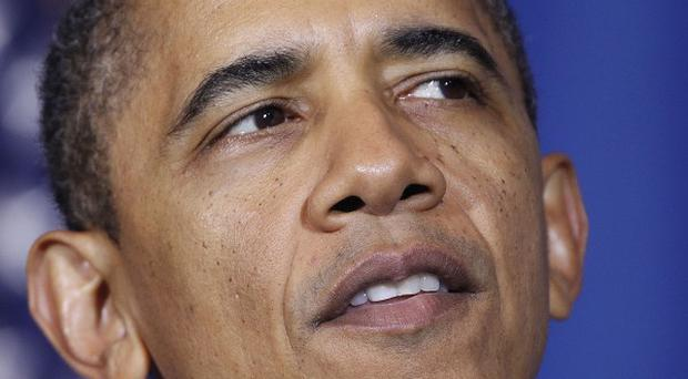 President Barack Obama has attacked his Republican challenger Mitt Romney over his stance on gay marriage (AP)