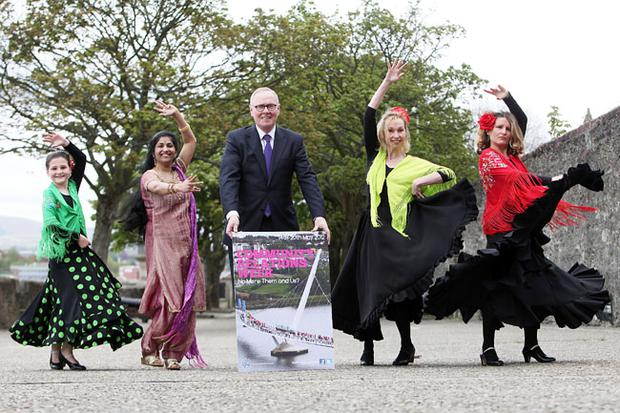 Tony McCusker, chairman, Community Relations Council, getting into the swing of things on Derry's Historic Walls with Bollywood dancer Jossy Aji and Flamenco dancers Carmel O'Donnell, Niki Gahan and Elena Ballesteros at the official launch of Community Relations Week