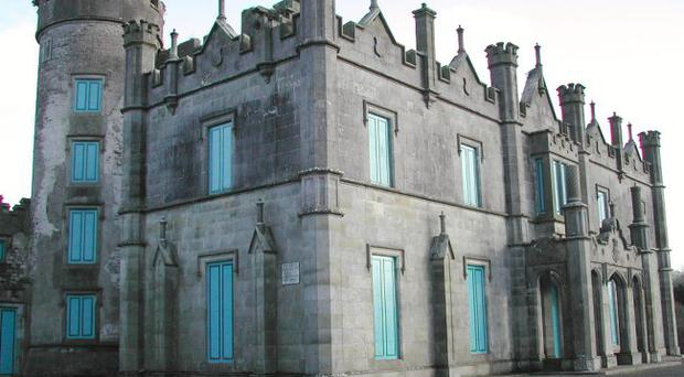 <b>Necarne Castle, Irvinestown</b> <br/>The castle is one of the more problematic buildings in Fermanagh, having featured in the first Buildings at Risk catalogue, along with estate cottages at Ballagh and the Georgian country house at Donagh. Described in its listing record as a 'large mansion house in decorated castellated style with stone walls partly rendered', it has lain empty for a considerable time. The grounds have been successfully developed for equestrian sports, with the substantial courtyard buildings sensitively restored as part of an agricultural college. In the meantime, the main building remains mothballed. While rescuing the building would certainly be a major undertaking, it is of such importance that all avenues must be explored to find a new use.