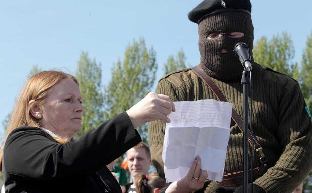 Jailed: Marian Price with a masked man during a 32 County Sovereignty Movement Easter commemoration