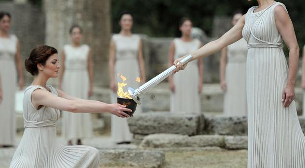 The Olympic torch is lit by an actress dressed as the High Priestess during a ceremony organised by the Hellenic Olympic Committee in Greece