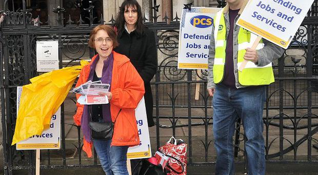 Members of the Public and Commercial Services Union protest outside the High Court in London