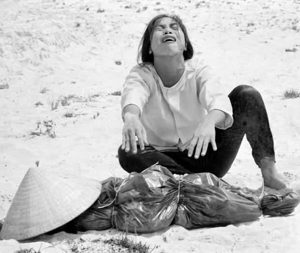April 1969 - shot by Associated Press photographer Horst Faas, a South Vietnamese woman mourns over the body of her husband, found with 47 others in a mass grave near Hue, Vietnam.
