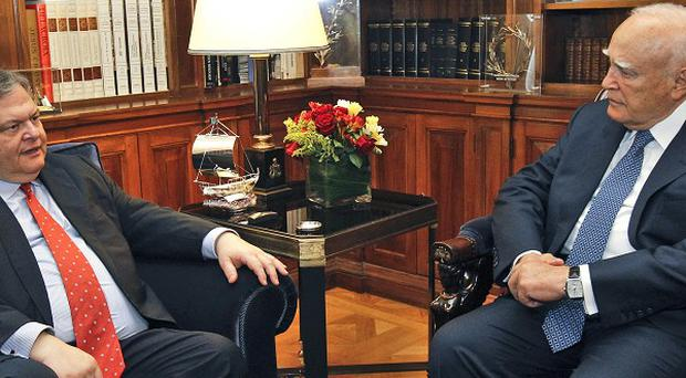 Leader of the PASOK party Evangelos Venizelos, left, meets President Karolos Papoulias before starting a new bid to form a coalition (AP)