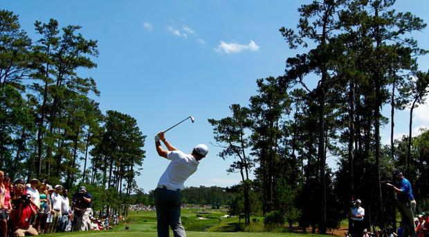 Rory McIlroy fires a shot down the fairway durign his first round at the Players Championship at Sawgrass