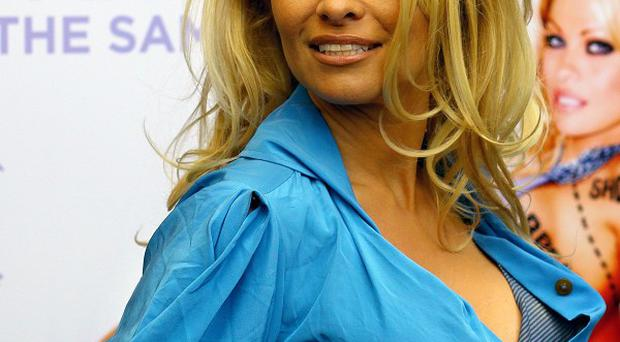 Pamela Anderson is the proud owner of new puppy Pyari