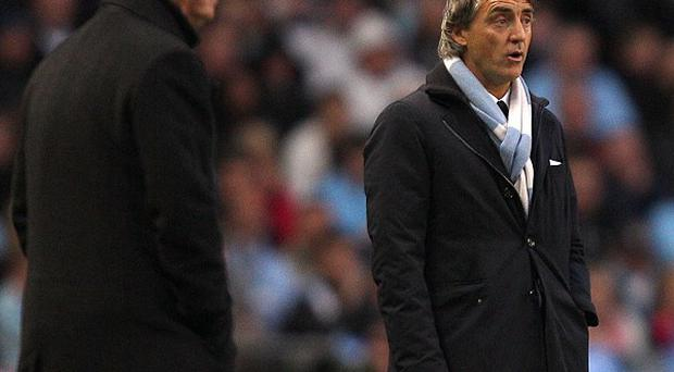 Alex Ferguson (left) and Roberto Mancini