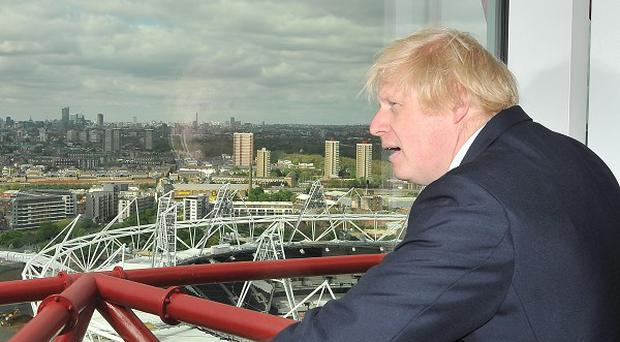 London Mayor Boris Johnson looks out from the public viewing platform of the newly completed ArcelorMittal Orbit