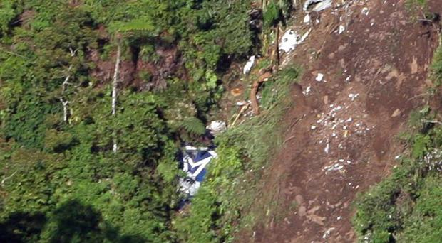The logo of Sukhoi is visible among the wreckage of a Sukhoi Superjet-100 scattered on the mountainside in Indonesia (AP)