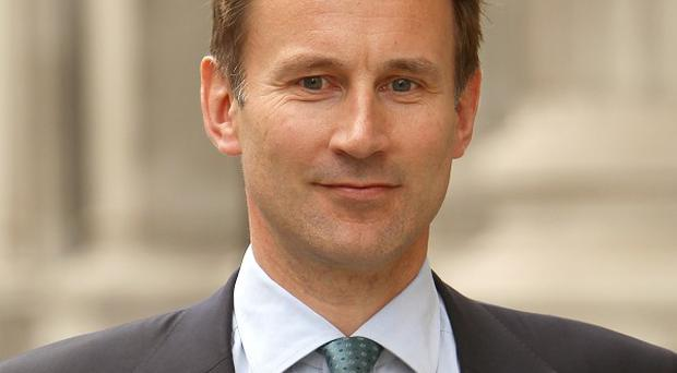 Jeremy Hunt is alleged to have asked News Corporation to guide the Government's positioning on phone hacking