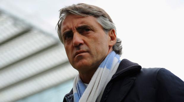 Roberto Mancini's Manchester City are odds-on favourites to be crowned Premier League champions