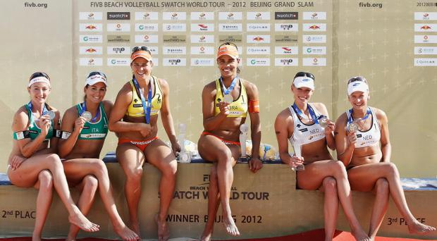 BEIJING, CHINA - MAY 12: (L-R) Marta Menegatti and Greta Cicolari of Italy; Larissa Franca and Juliana Felisberta Da Silva of Brazil; Sanne Keizer and Marleen Van Iersel of Netherlands present their medals during the medal ceremony of the 2012 Swatch FIVB World Tour Beijing Grand Slam in Chaoyang Park on May 12, 2012 in Beijing, China.(Photo by Lintao Zhang/Getty Images)