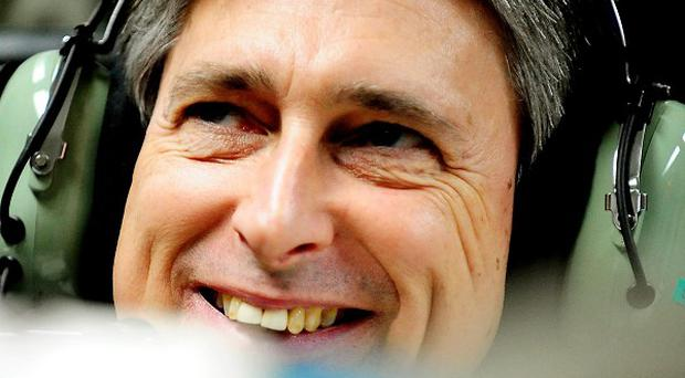 Philip Hammond said he has plugged the 38 billion pound 'black hole' in the defence budget