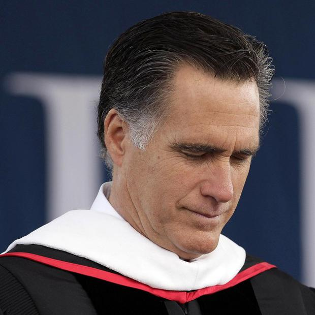 Republican presidential candidate Mitt Romney prays before his commencement address at the Liberty University in Lynchburg, Virginia (AP)