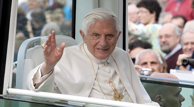 Pope Benedict XVI delivers his blessing from inside his vehicle as he arrives to celebrate Mass in Arezzo, Italy (AP)