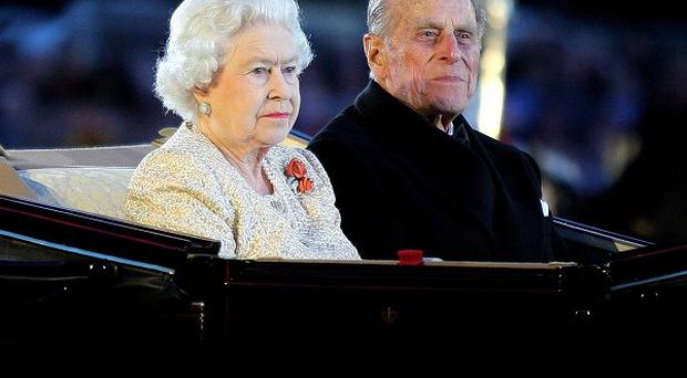 The Queen and the Duke of Edinburgh arrive at the Diamond Jubilee Pageant in Windsor
