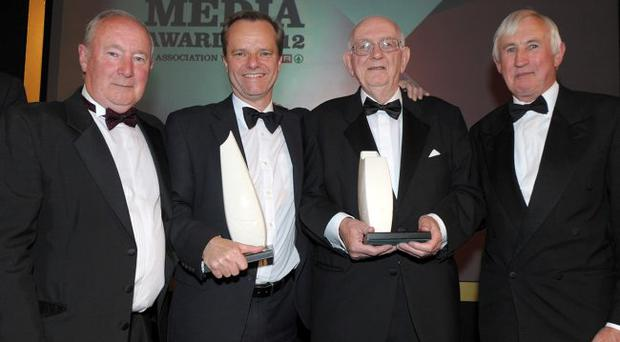 Mike Gilson (second left), editor of the Belfast Telegraph, joins former editors Martin Lindsay (left) and Ed Curran (far right) in congratulating Roy Lilley on his Lifetime Achievement Award