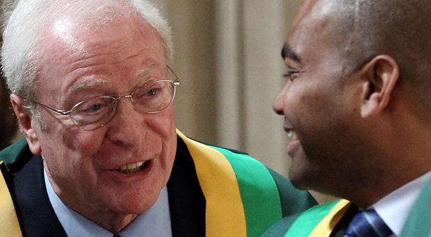 Sir Michael Caine talks to Lance Corporal Johnson Beharry before they are awarded the Freedom of the Borough of Southwark during a ceremonial presentation at St George's Cathedral, London