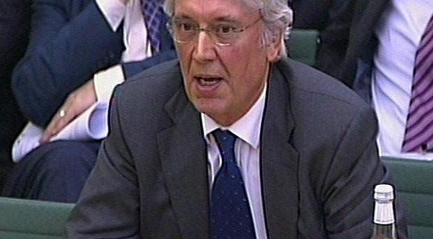 Les Hinton has denied claims he was involved in a cover-up of the phone hacking scandal
