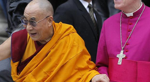 The Dalai Lama, left, with St Paul's Cathedral Canon Pastor Reverend Michael Colclough, arrives to receive the 2012 Templeton Prize (AP)