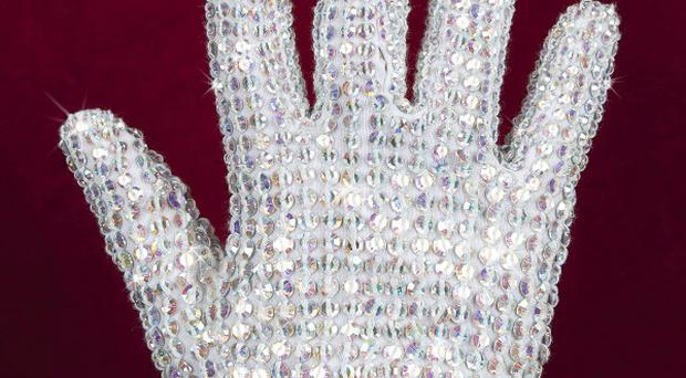 Up for grabs, Michael Jackson's glove is part of his wardrobe being auctioned (AP)f