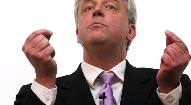 Health Secretary Andrew Lansley has been heckled by nurses at the RCN conference in Harrogate