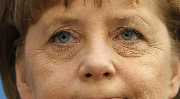 German chancellor Angela Merkel hs dismissed poor local election results (AP)