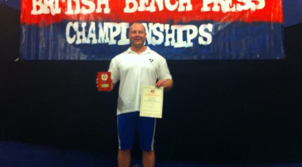 Strongman: Brian Coombes with his award won at the British Benchpress Championships in Birmingham last week