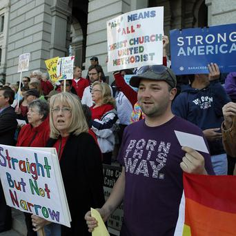 Supporters of Civil Unions rally in Denver as Colorado lawmakers were called back into a special session to vote on several bills including Civil Unions. (AP Photo/Ed Andrieski)