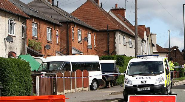 A general view of the scene in Allenton, Derby, after six children died in a house fire