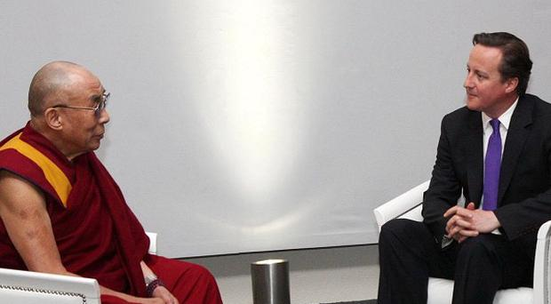 The Dalai Lama met with David Cameron and Nick Clegg in London