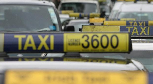 Taxi drivers have been urged to stop using additional green lights on their roofs