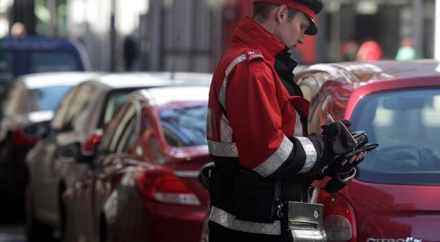 A traffic warden pictured on Linenhall Street in Belfast City Centre