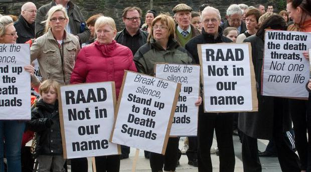 Protesters against RAAD with placards