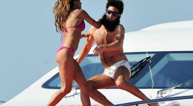 Admiral General Aladeen and supermodel Elisabetta Canalis spotted on a luxury yacht at Hotel Du Cap during 65th Annual Cannes Film Festival on May 16, 2012 in Cannes, France.