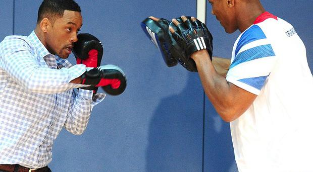 Will Smith trains with Anthony Joshua, GB Super Heavyweight boxer, at the Ethos Sports Centre in Imperial College, London
