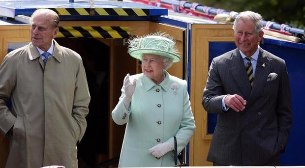 The Queen was joined by the Duke of Edinburgh and Prince of Wales for a trip along the Leeds and Liverpool canal on a barge