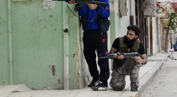 Syrian activists have said that regime forces are continuing their attacks (AP)