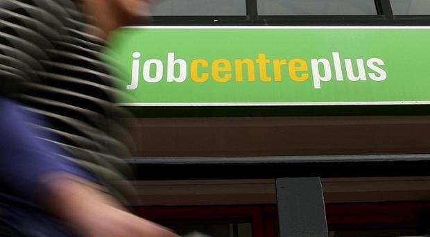 The number of unemployed people fell by 45,000 in the three months to March, new figures show