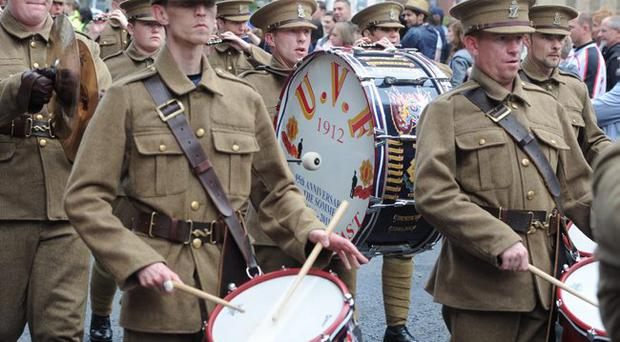 History in the making: left, a Belfast flute band in old-style costume, with UVF painted on their bass drum, marching last year on the 12th of July.