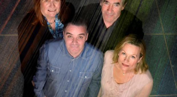 Artist Mark Garry (front left), Penny Holloway, Jim Devlin and Anne McReynolds, chief executive of the MAC, stand under the new artwork